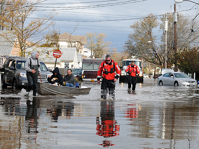 <p>Rescue workers search for people in homes on Grimsby Avenue, Midland Beach, where two elderly women were found dead in their home after Hurricane Sandy, Oct. 31, 2012.</p>