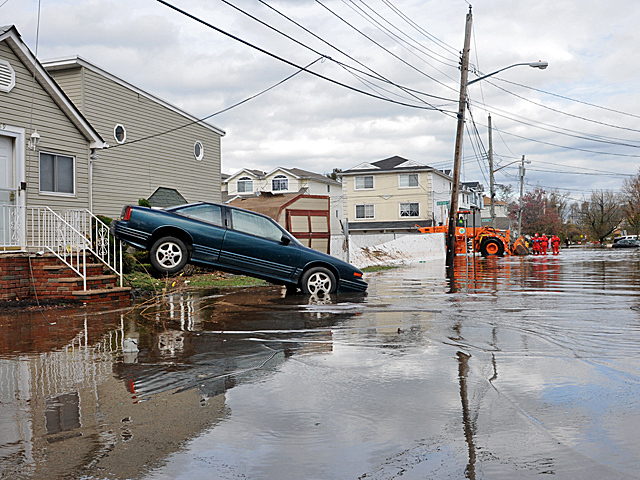 <p>A car washed into the front lawn on Grimsby Avenue, Staten Island.</p>