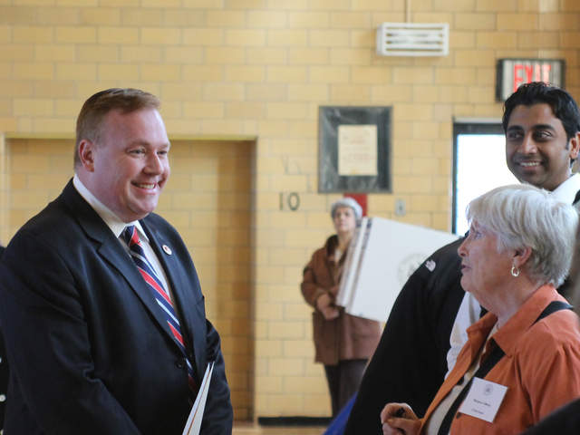 <p>City Councilman Dan Halloran chats with a poll worker at P.S. 184 in Whitestone on Nov. 6.</p>