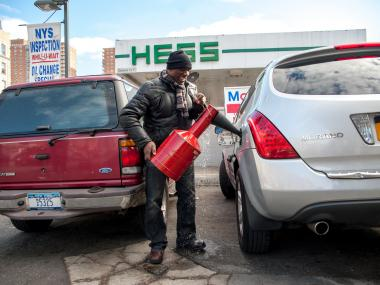Neville Gordon, who was fortunate enough to be loaned this gas can by an employee of the closed Mobil Gas Station next door, spills some of his precious commodity on Monday November 05th, 2012. Neville stood in line for two and a half hours.