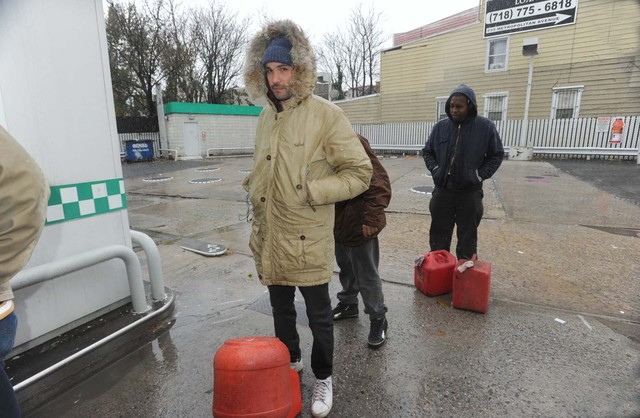 <p>Steve Brahms, 30, waited in the snow to get gas in Williamsburg on Wednesday.</p>