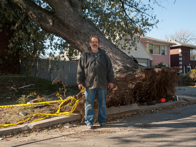 <p>John Greenholtz stands next to the tree that fell on his house during Hurricane Sandy on Tuesday November 06th, 2012.</p>