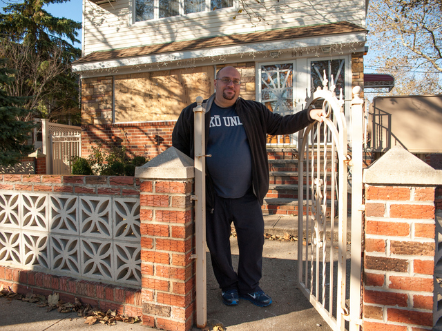 <p>Eddie Dibari stands in front of his damaged residence at the corner of 157th Avenue and 95th Street on Tuesday November 06th, 2012.</p>