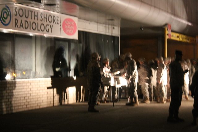 <p>National Guardsmen grab dinner before going on patrol in areas of Queens that still lacked power on Tuesday, Oct. 30, 2012.</p>