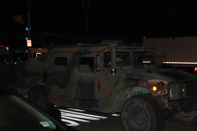 <p>A military vehicle double-parked along Cross Bay Boulevard in Howard Beach Tuesday, Oct. 30, 2012.</p>