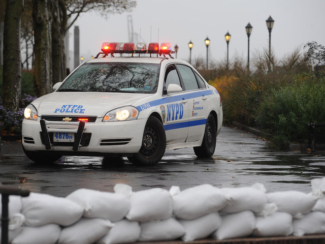 <p>A police car parked at the entrance to Battery Park.</p>