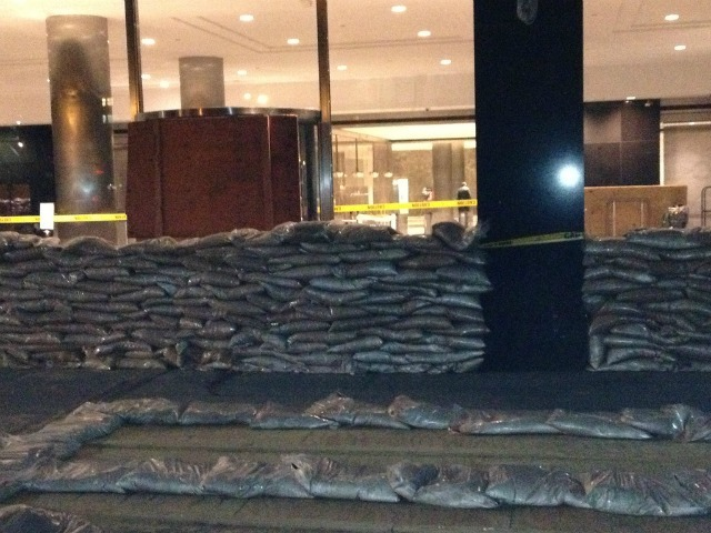 <p>Sandbags stacked in front of MTA headquarters at 2 Broadway in lower Manhattan on Sunday, Oct. 22, 2012.</p>