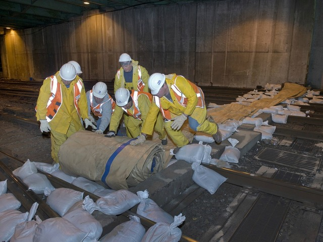 <p>Crews set up a dam at the West Side rail yards to prevent possible flooding from Hurricane Sandy.</p>