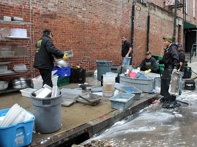 <p>Workers at the South Street Seaport clean restaurant equipment that was salvaged from the flood wreckage caused by Hurricane Sandy.</p>