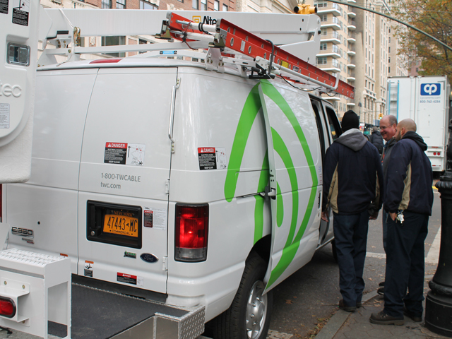 <p>A Time Warner crew helped loop cable around a light post at the intersection of Central Park West and 67th Street.</p>