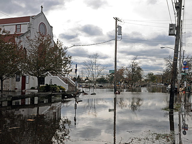 <p>Parts of Cedar Grove Avenue in Staten Island were still flooded three days after Hurricane Sandy pummeled Staten Island, Nov. 1, 2012.</p>