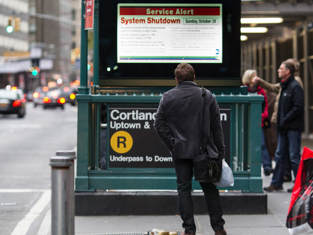 <p>A man checked the latest MTA travel updates near the World Trade Center as New York prepared for Hurricane Sandy on Oct. 28, 2012.</p>