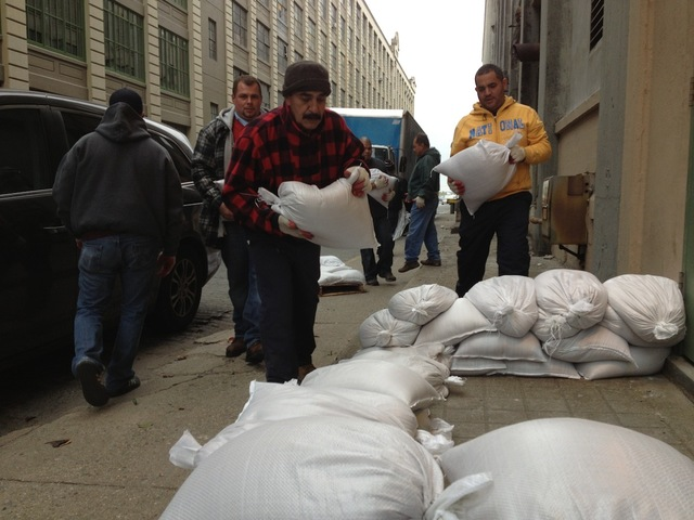 <br /> <p>An emergency crew for Industry City Partners lays sandbags outside one of the company&#39;s buildings on Third Avenue on October 28, 2012, in preparation for Hurricane Sandy.</p>