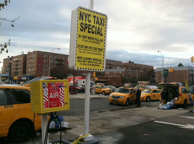 <p>A sign advertises a &quot;NYC Taxi Special&quot; at a Jackson Heights Shell station. The companies listed on the sign all belong to Evgeny Freidman.</p>