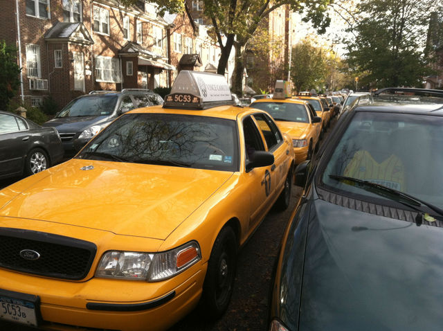 <p>Cabs lined up for blocks to wait for gas at a Jackson Heights Shell station, as locals were turned away.</p>