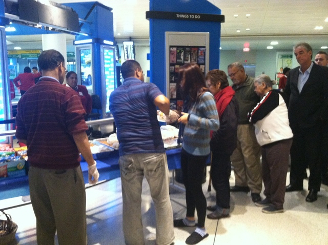 <p>Stranded passengers lined up for free sandwiches at JFK Airport Oct. 31, 2012.</p>