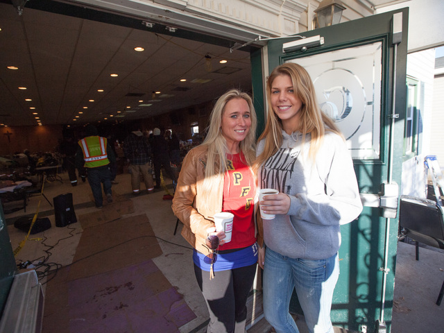 <p>(L-R) Kaitlin Doyle, 21, and Athena Dever, 26, local residents who have spent days helping out after Hurricane Sandy hit the Rockaways last week.</p>