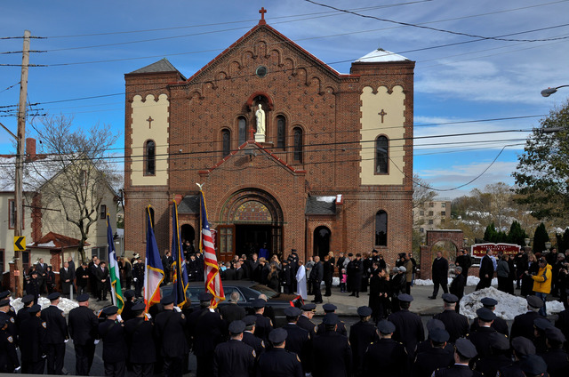 <p>Hundreds of police officers mourned the loss of Arthur Kasprzak, who died saving family during Hurricane Sandy, in New Brighton, Nov. 8, 2012.</p>