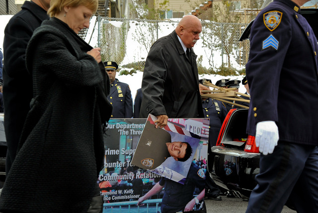 <p>Arthur Kasprzak, who lost his life helping family during Hurricane Sandy, was pictured on a poster for the police academy. Hundreds of police officers, Mayor Michael Bloomberg, Commissioner Raymond Kelly, were on hand to mourn the loss of Kasprzak in New Brighton, Nov. 8, 2012.</p>