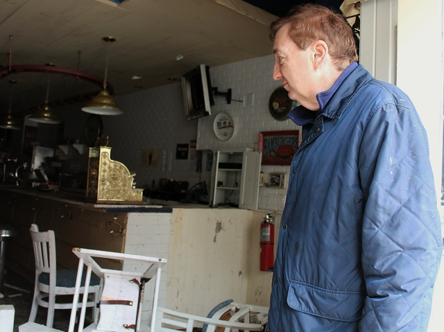 <p>Manager Kevin Barry surveys the damage caused by Hurricane Sandy at Grandma&#39;s House, a restaurant on Peck Slip in the South Street Seaport. The eatery, which just opened three months ago, suffered extensive flooding during the storm.</p>