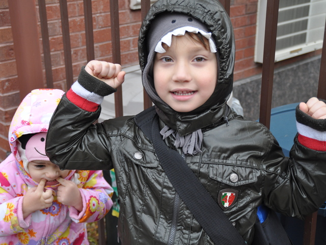 <p>Giacomo DeJoseph, 5, stood in front of P.S. 132 next to his younger sister Eliana, 3, and cheered to return to kindergarten after a week without class.</p>