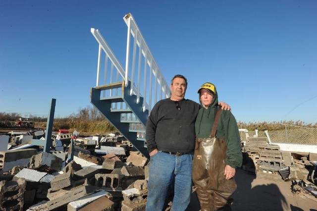 <p>Vincent and Jane Caravello at the remains of their home destroyed by Hurricane Sandy.</p>