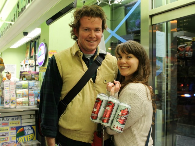 <p>Andrew Mulligan and Katie Maceira stocked up on the essentials: pita chips and beer.</p>