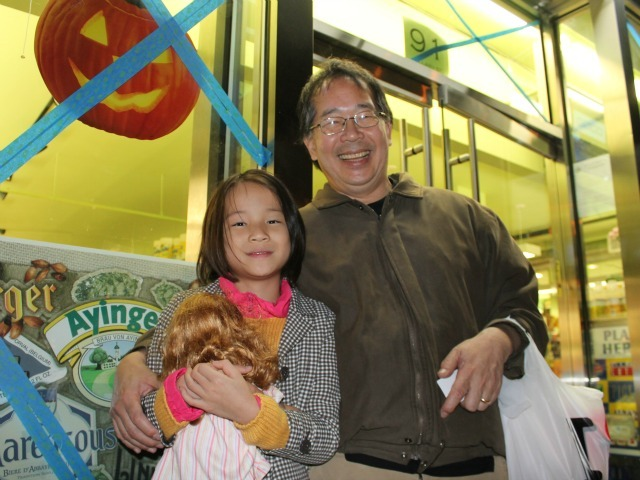 <p>Dad Ross Takahashi and his daughter Iris, 9, stocked up on the most essential item for any day off school: ice cream.</p>