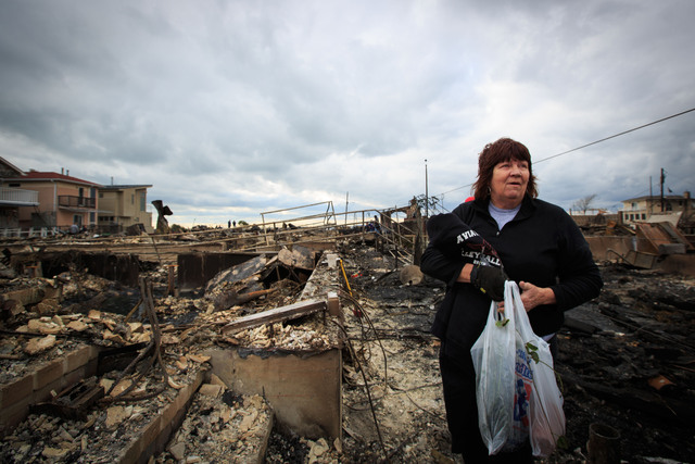 <p>Linda Strong stood before the remains of her house, where she has been 37 years. She&rsquo;s determined to rebuild and return here at Breezy Point.</p>
