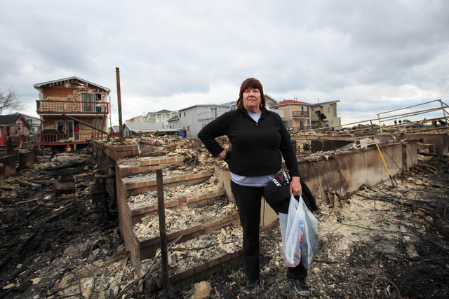 <p>Linda Strong was hard at work cleaning up the remains of her house in Breezy Point on October 31, 2012.</p>
