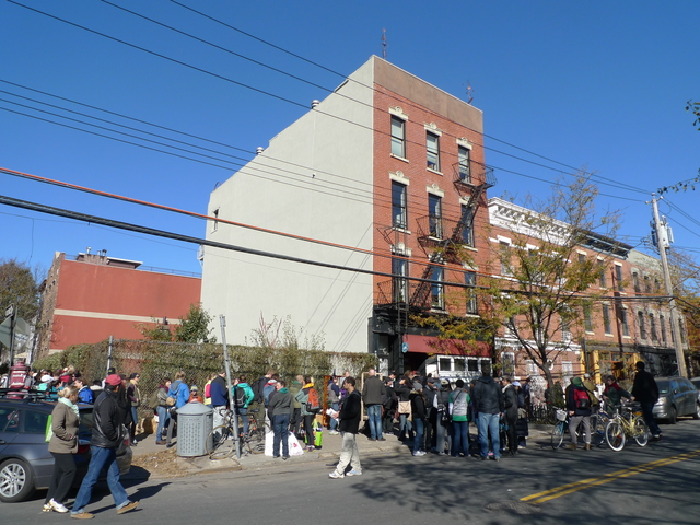 <p>A line of volunteers stretched around the block at the newly formed Hurricane Sandy clean-up group, Red Hook Recovery on Van Brunt Street, on Nov. 4, 2012.</p>