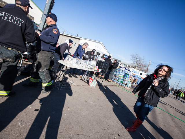 <p>Local residents and volunteers get hot refreshments outside the Rockaway Point Volunteer Fire Station in the Rockaways on Nov. 5, 2012.</p>