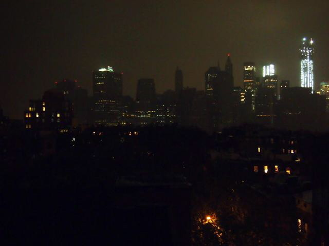 <p>The east side of Manhattan went dark about 8:30 p.m. Monday as Hurricane Sandy tore through the city, causing mass power outages, flooding and other damage.</p>