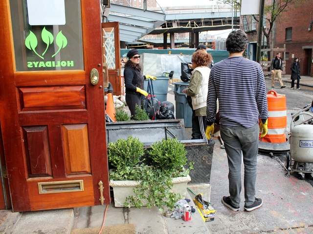 <p>Workers help clean up the office for Manhattan Plant Design, a horticultural design firm on Front Street that was flooded during Hurricane Sandy.</p>