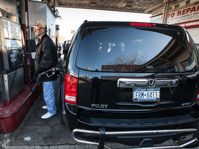 <p>Matthew Dimmler, 58, from Long Island City, Queens fills up his car on 39th Ave and 21st on Nov. 9th, 2012.</p>