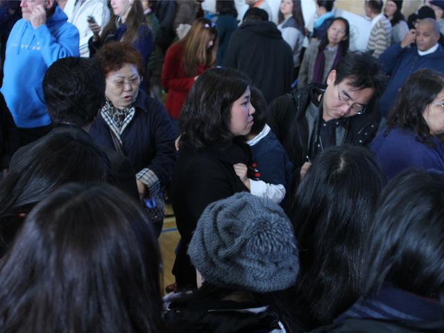 <p>Surrounded by reporters, Assemblywoman Grace Meng waits to vote at P.S. 214 in Flushing on Nov. 6.</p>