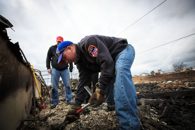 <p>Fireman Michael Strong worked hard to help rebuild the community on October 31, 2012.</p>