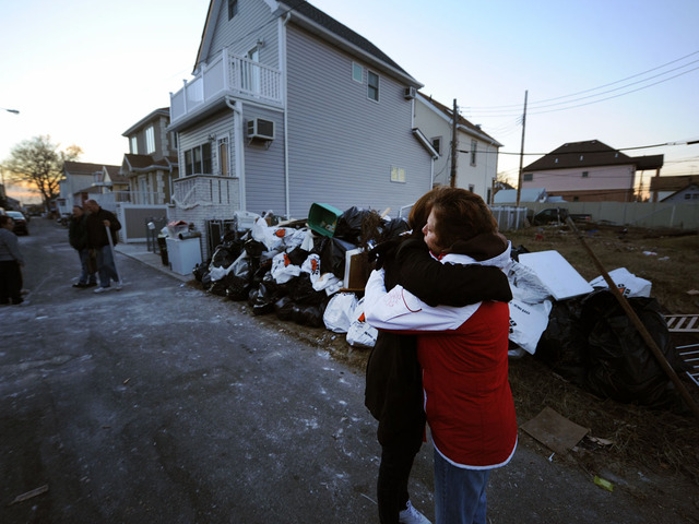 <p>Gerritsen Beach resident Michele McCormick, whose home was damaged by Hurricane Sandy, hugs her neighbor.</p>