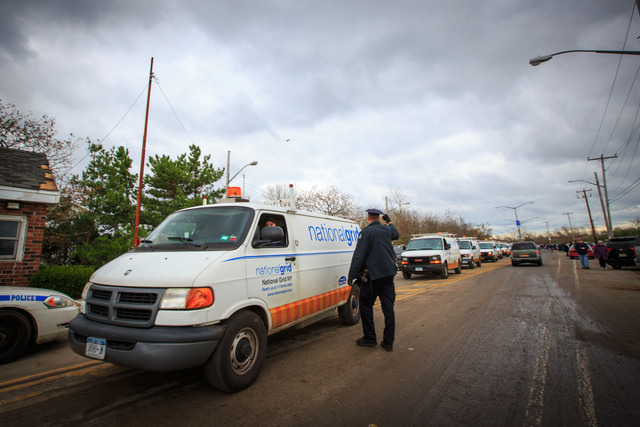 <p>A line of National Grid vans headed into Breezy Point on October 31, 2012 to check the electrical system in the area.</p>