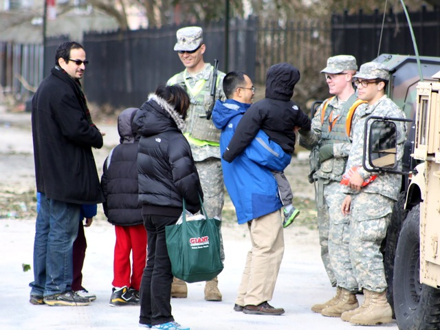 <p>Members of the National Guard talking to Coney Island residents.</p>