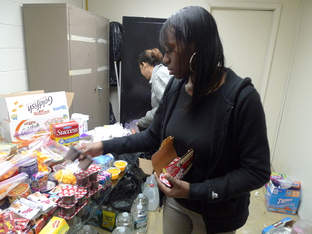 <p>Nicole Harris, a 31-year-old mom of three who lives in Red Hook Houses, helped sort donations at Calvary Baptist Church after Hurricane Sandy.</p>