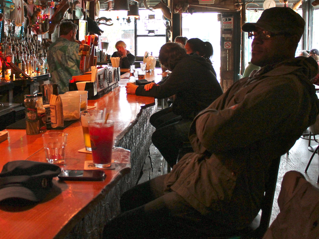 <p>Carroll Gardens resident Nixon Thelusmond sits at the bar at Red Hook Bait &amp; Tackle ahead of Hurricane Sandy Sunday, Oct. 28, 2012.</p>