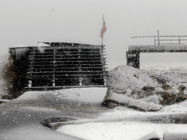 <p>Snow falls on a destroyed section of boardwalk as a Nor&rsquo;Easter approaches in the Rockaway neighborhood on November 7, 2012 in the Queens borough of New York City. The Rockaway Peninsula was especially hard hit by Superstorm Sandy and some are evacuating ahead of the coming storm.</p>