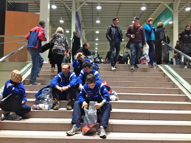 <p>Disappointed runners sit on the steps of the Javitz Center Marathon Expo moments after learning that the NYC Marathon was canceled on November 2, 2012.</p>