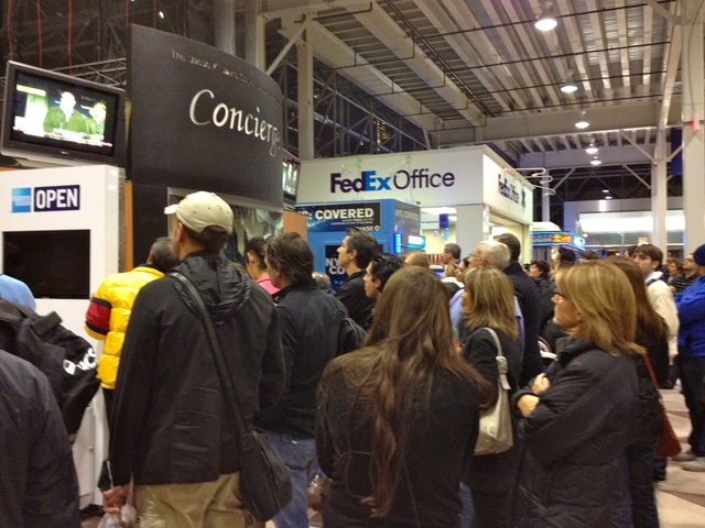 <p>Runners gathered at the Marathon Expo watch as officials announce the cancelation of the NYC marathon on November 2, 2012.</p>