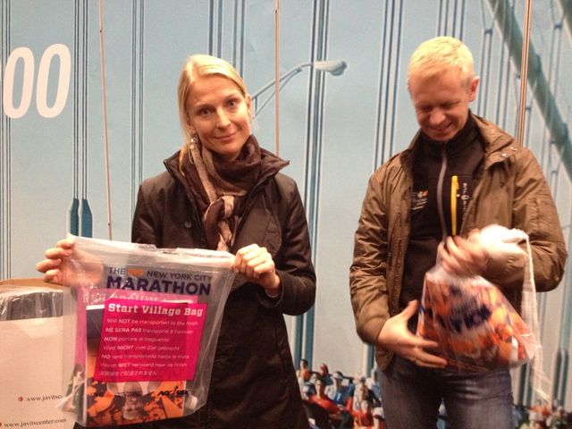 <p>Malin Brostrom, 37, from Sweden, holds her runner&#39;s packet at the Marathon Expo on November 2, 2012. She said her trip to NYC for the Marathon cost more than $3,000</p>