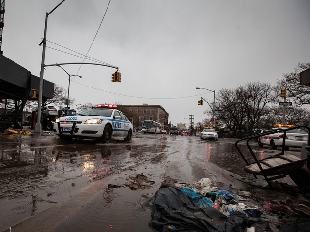 <p>The NYPD patrol the Rockaway Beach as heavy rain and strong winds began to pound the area on Nov. 7, 2012.</p>
