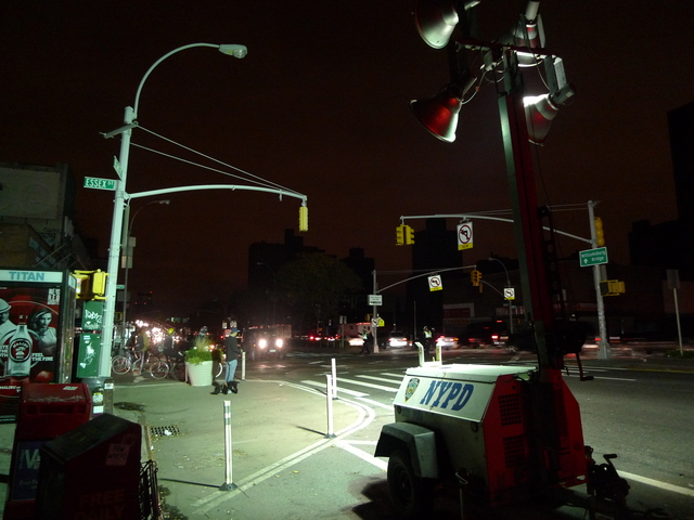 <p>An NYPD spotlight provides much-needed light at Delancey and Essex after Hurricane Sandy knocked out power in lower Manhattan.</p>