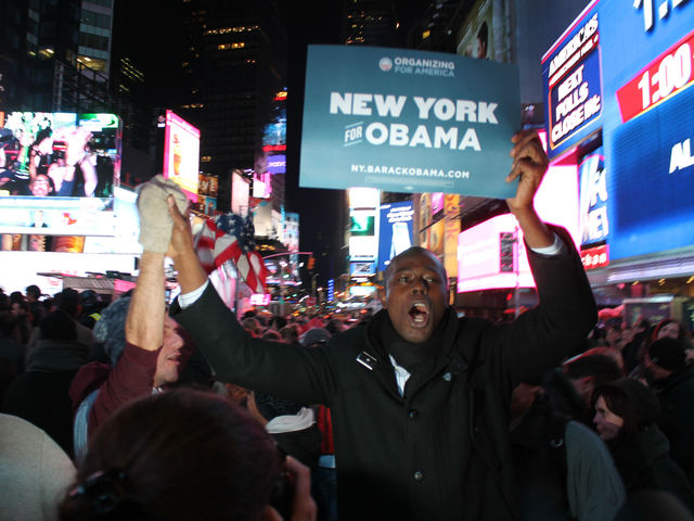 <p>James Lauala, 42, celebrates in Times Square after Barack Obama is declared the winner of the 2012 Presidential Election.</p>