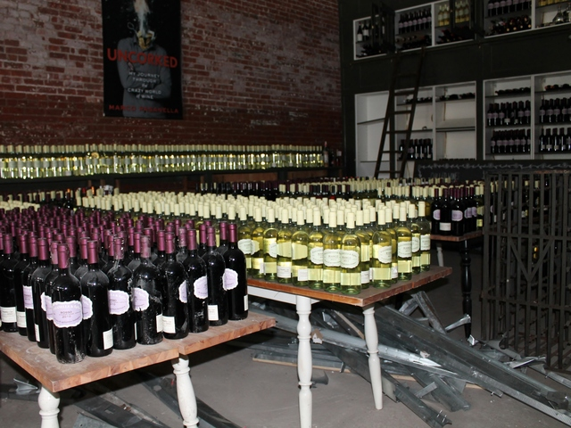 <p>&nbsp;Pasanella &amp; Son Vinters, a wine store on Front Street, was able to save a lot of their inventory from storm damage by moving it into storage above the shop before it flooded.</p>